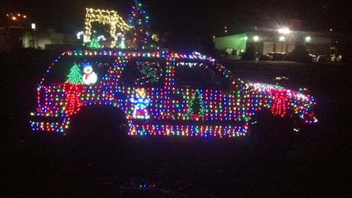 car covered in LED Christmas lights