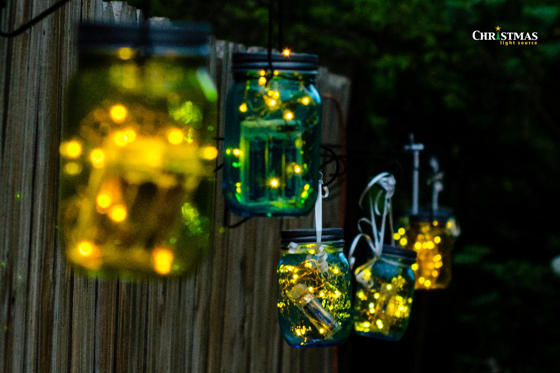 cls mason jars lit on fence