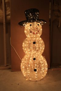 White lights bring a snowman back to life!
