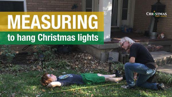 Measuring to hang Christmas lights – use your family!